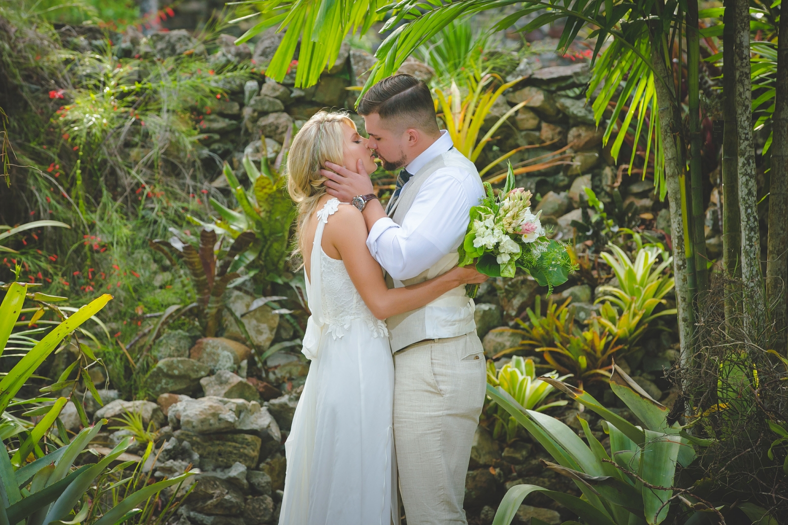 St. Croix wedding couple kissing in botanical garden
