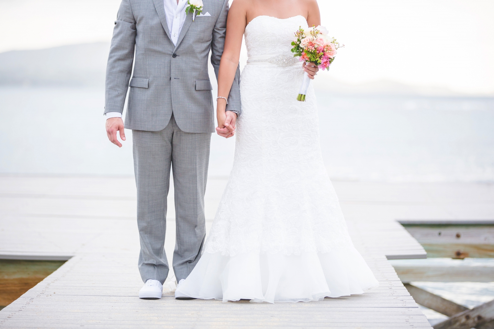 St. Croix wedding couple staying on dock holding hands