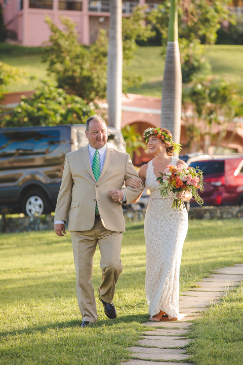 St. Croix bride walking down the aisle with father