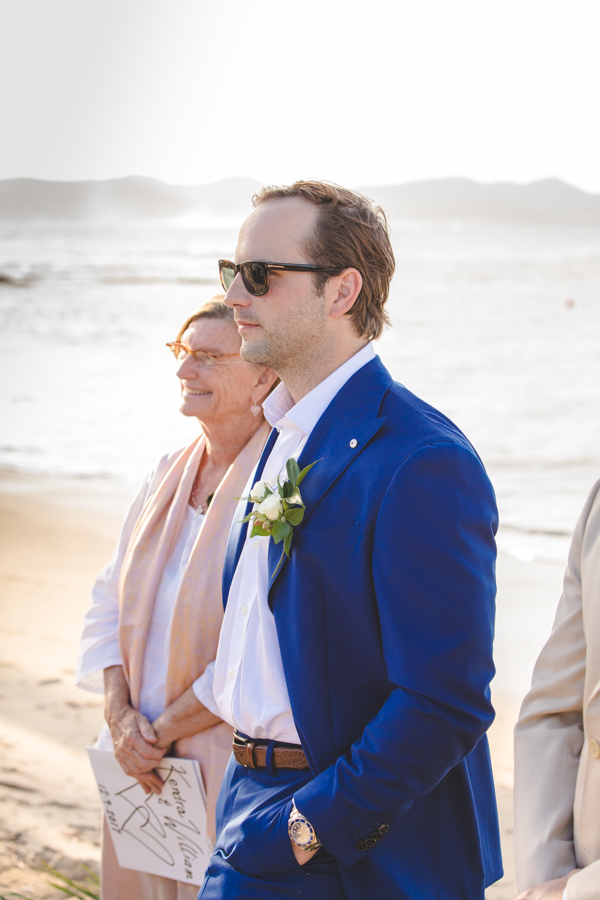 St. Croix groomstanding at the top of the aisle With a officiant