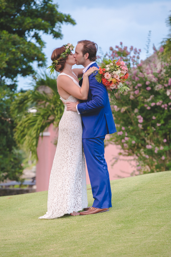St. Croix bride and groom kissing in front of sugar mill