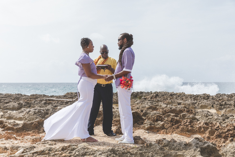 St. Croix bride and groom exchanging vows on rocky beach