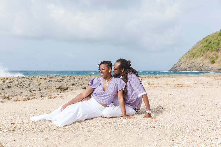 St. Croix bride and groom sitting and I laughing on rocky beach