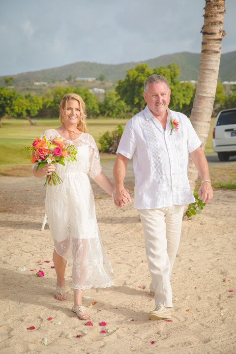 St. Croix bride and groom walking down the aisle on beach