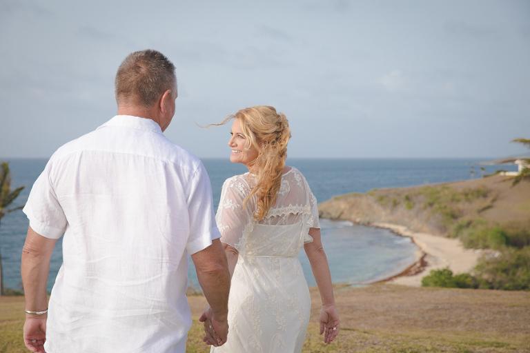 St. Croix bride leading groom on hillside
