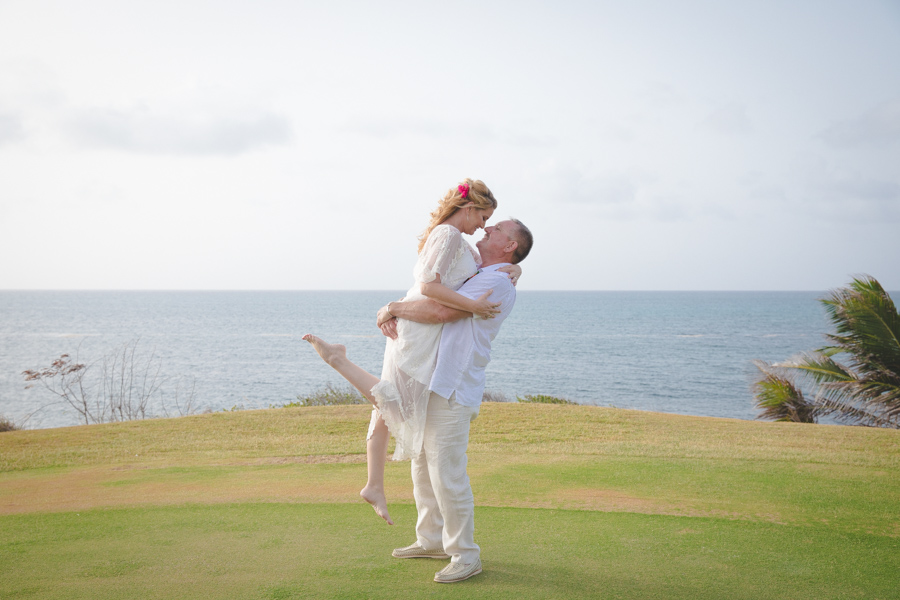 St. Croix groom lifting bride in the air while they kiss