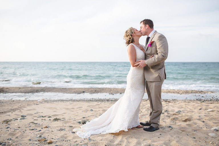 St. Croix bride and groom kissing on the beach
