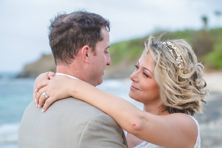 St. Croix bride and groom looking each other in the eyes on the beach
