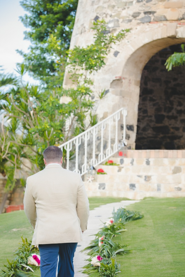 St. Croix groom walking down the aisle to Sugar Mill
