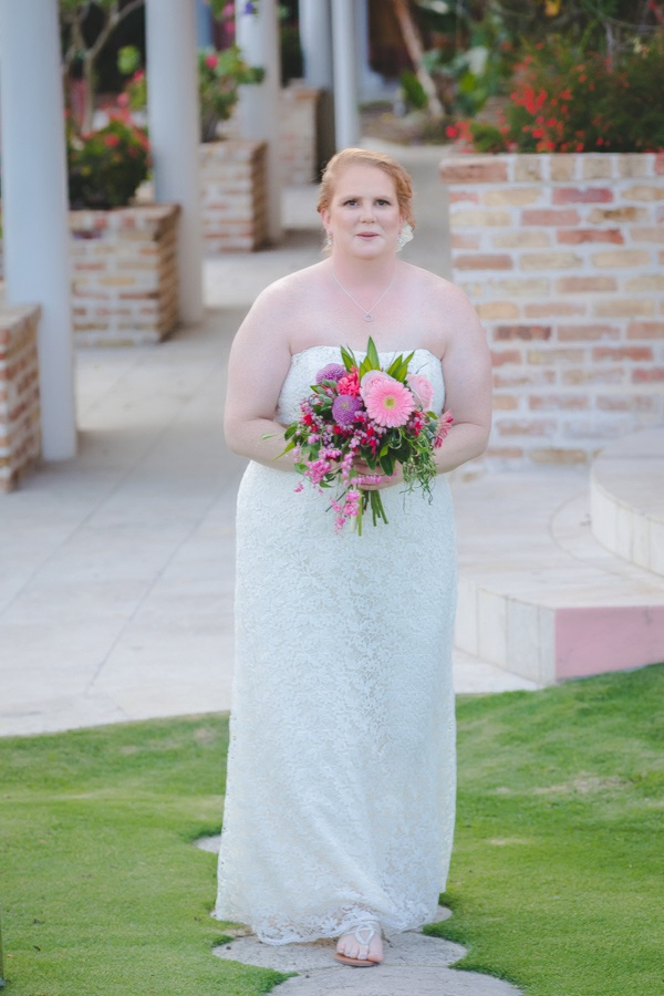 St. Croix bride walking up the aisle to sugar mill