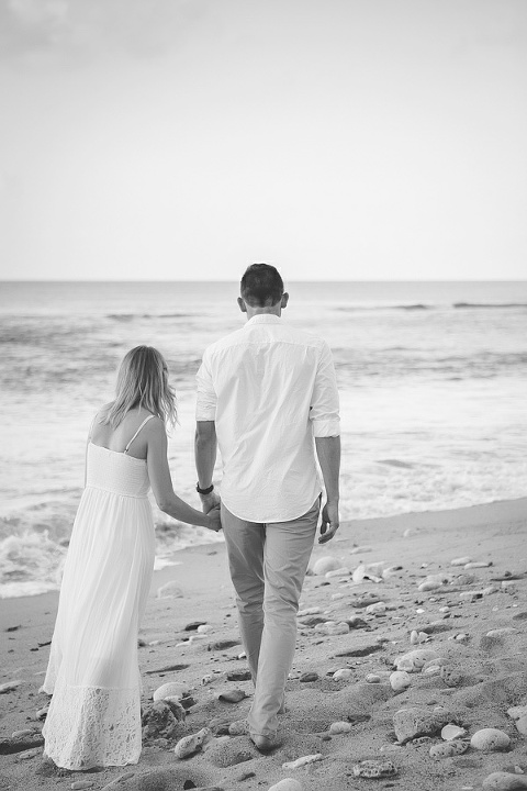 black and white image of St. Croix bride and groom walking down the beach