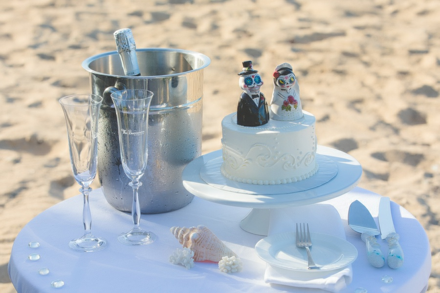 St. Croix bride and groom wedding cake on beach
