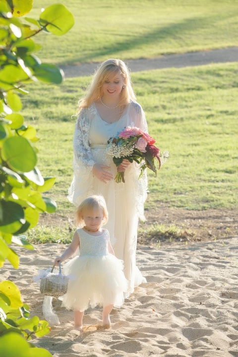 St. Croix bride and child walking down the aisle on beach