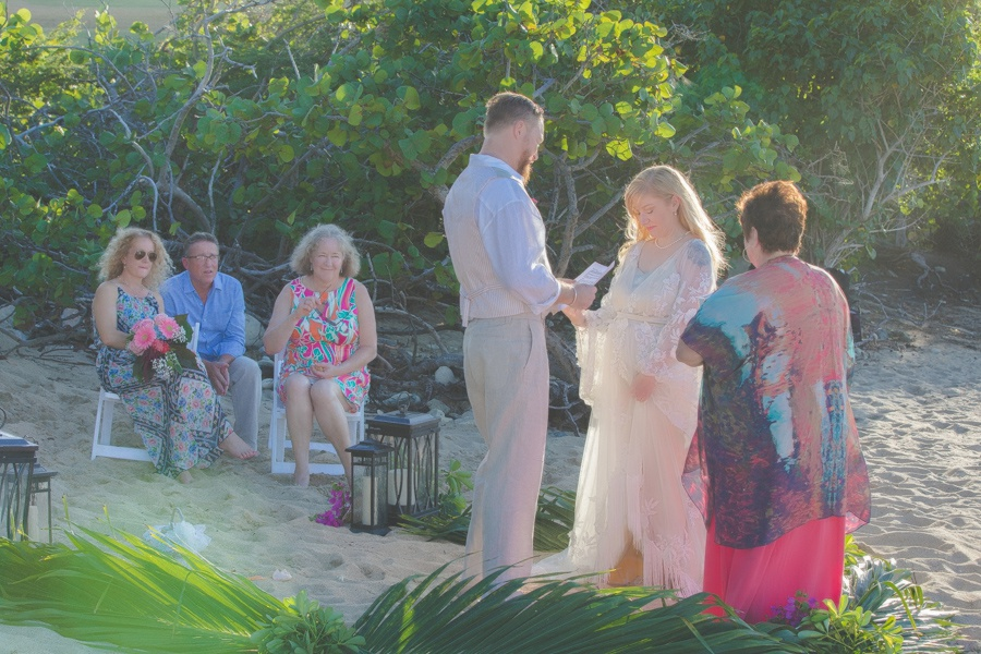 St. Croix bride and groom exchanging wedding vows on beach