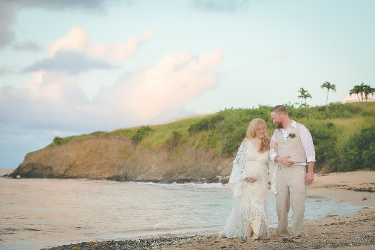 St. Croix bride and groom walking arm and arm on beach smiling